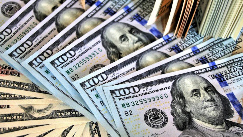Dollars piled up